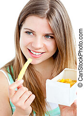 Radiant young woman eating fries