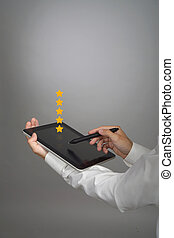 Five star rating or ranking, benchmarking concept. Man with...
