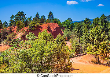 Picturesque orange-red hills of ochre - Picturesque...