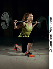 Woman Lifting Weight. Crossfit.