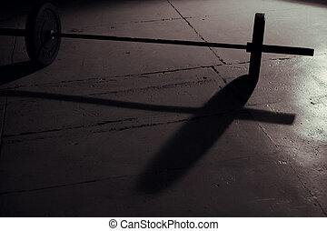 Barbell backlight and shadow in gym
