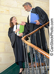 Judges descending staircase