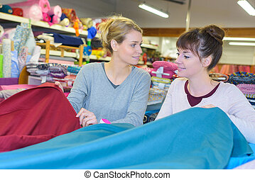 Two women in textiles shop