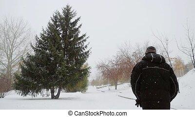Man walking in beautiful winter landscape in slowmotion....