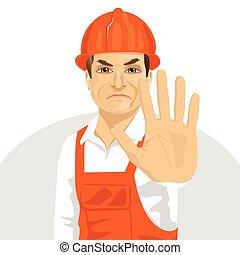 mature road worker in hard hat showing stop gesture - mature...