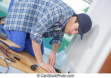 man worker installing plinth