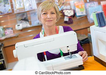 dressmaker posing and smiling