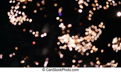 Beautiful explosions of fireworks in the night sky bokeh