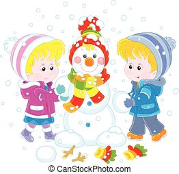 Children making a Christmas snowman - A little girl and a...