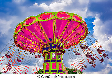 Colorful flying swing ride at the amusement park