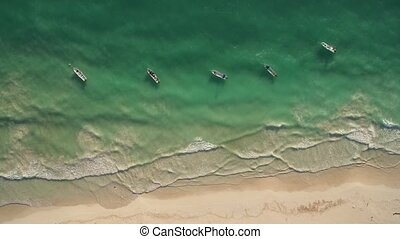 aerial view of beach and boats - Boats around the coastline...