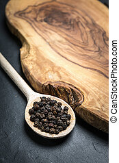 black pepper on rustic wooden table with copy space