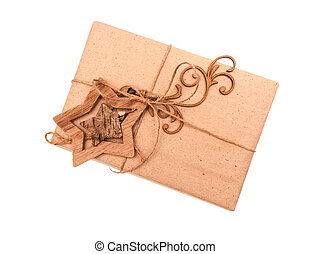festive box of kraft paper with toy wooden star