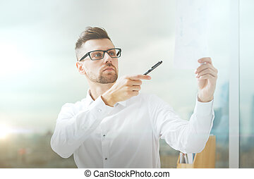 Handsome businessman with document - Portrait of handsome...