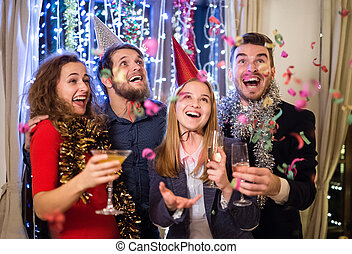 Group of friends having party on New Years Eve. - Group of...
