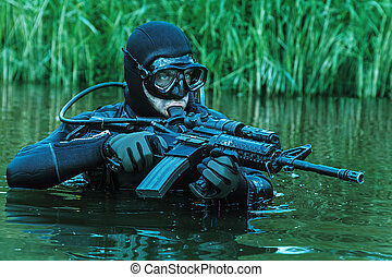 Navy SEAL frogman with complete diving gear and weapons in...