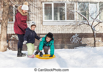 Family resting outdoors in winter