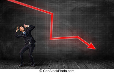 Small frightened businessman under huge red kinked arrow pointing down
