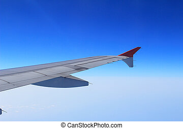 Ailerons and flaps tucked flat in airplane wing at cruise...