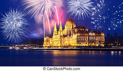 Budapest Parliament with fireworks - New Year in the city -...