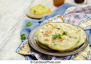 Indian Potato stuffed Flatbread. Aloo Paratha. toning....