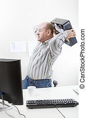 Businessman Throwing Computer Chassis By Desk - Angry mature...