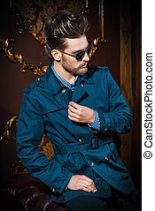 imposing style - Portrait of a well-dressed imposing man in...
