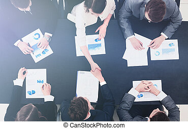 business handshake in office