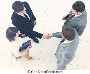 Business meeting. Top view of four people in formalwear...