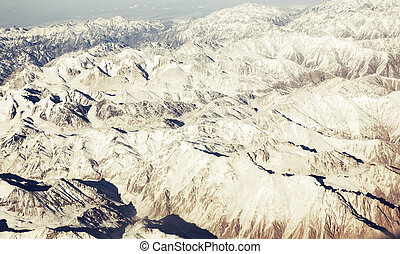 Panorama mountain relief from the window of the passenger...