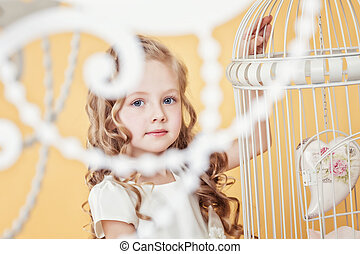 Image of lovely little girl with long curly hair