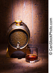 Glass of whiskey and small barrel on wooden table - Glass of...