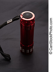 red LED torch on a black background