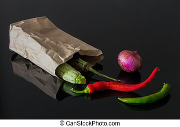Fresh organic vegetables in a paper bag