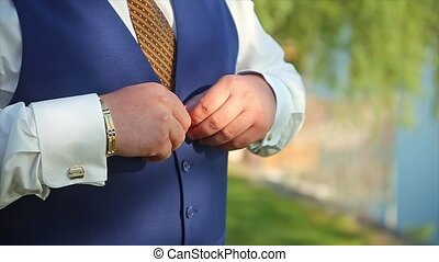 Man Buttoning Waistcoat Preparing to Wedding Groom natural...
