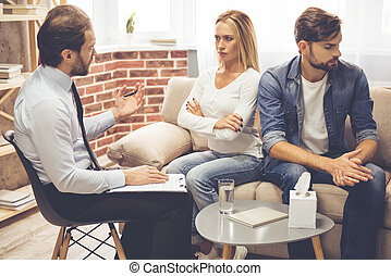 Couple at the psychologist - Beautiful young couple is...