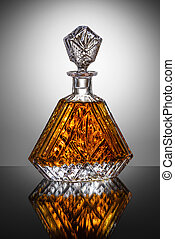 Carafe of brandy on dark background