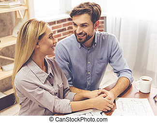 Couple and a realtor - Beautiful couple is holding hands,...