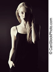 dark portrait - Portrait of a gorgeous blonde woman with...