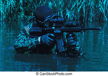 Frogman with weapons - Frogman with complete diving gear and...