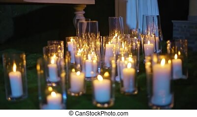 Burning Candle in Glass Vase