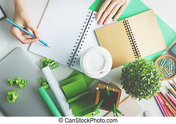 Girl writing in spiral notepad - Girl with various creative...