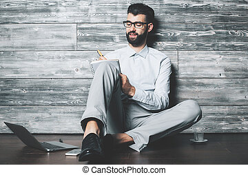 Guy with notepad
