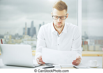 Handsome guy with document - Portrait of handsome european...