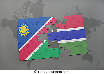 puzzle with the national flag of namibia and gambia on a...