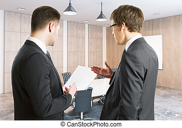 Young businessmen discussing contract