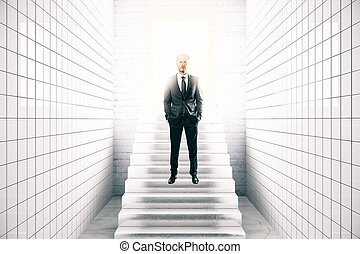Success concept - Front view of young businessman in white...
