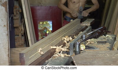 Hands of a carpenter planed wood, workplace - Man is working...
