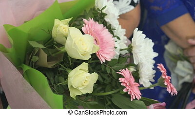 Woman holds bouquet of multicolor flowers - Woman holds a...