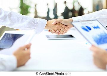 handshake business partners after the conclusion of successful contract
